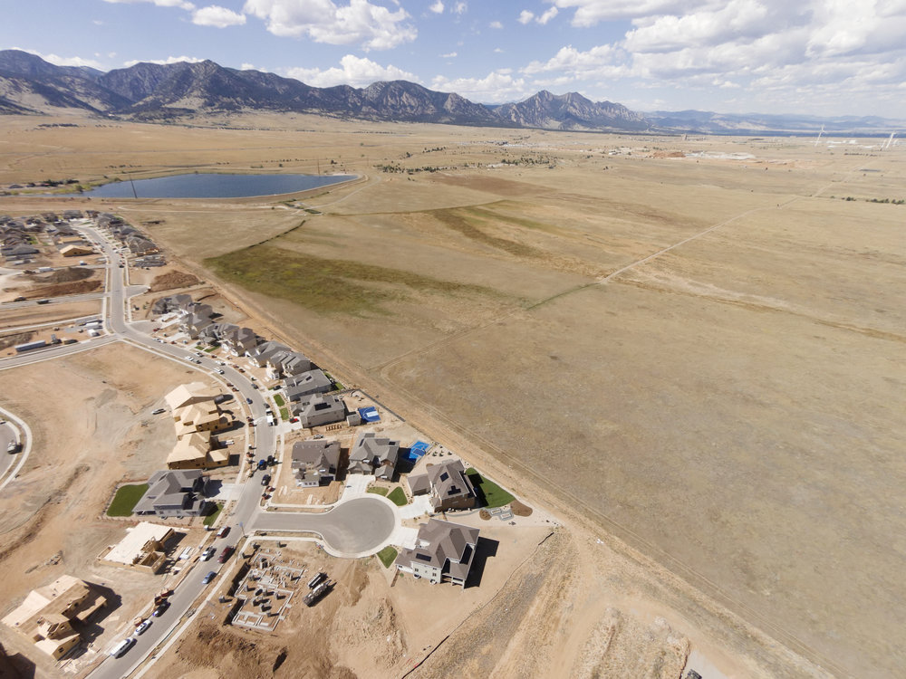 RESIDENTIAL DEVELOPMENT 1.5 MILES DOWNWIND FROM ROCKY FLATS, PLUTONIUM POLLUTED, NUCLEAR SUPER FUND SITE