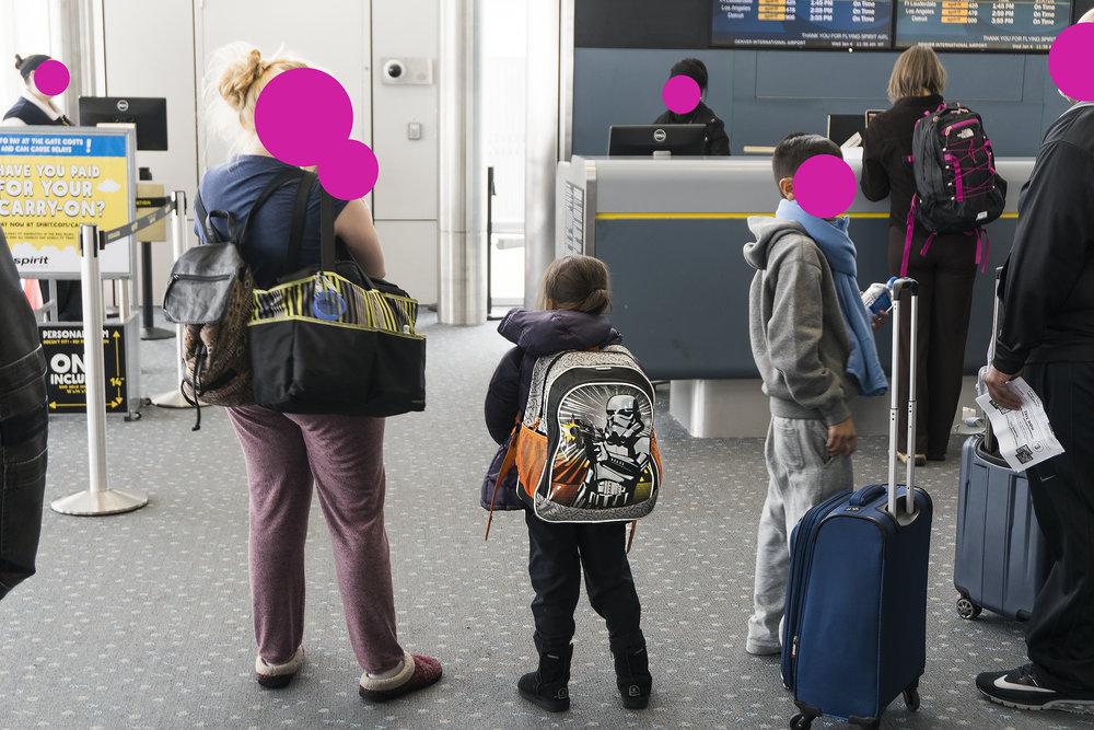 CHILD WITH STAR WARS BACKPACK, DENVER INTERNATIONAL AIRPORT
