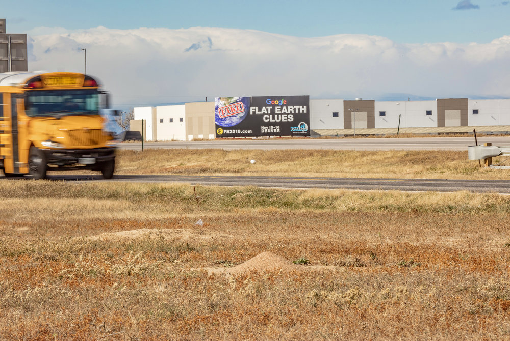 ADVERTISEMENT FOR FLAT EARTH CONVENTION/SCHOOL BUS/ANTHILL. DENVER, COLORADO