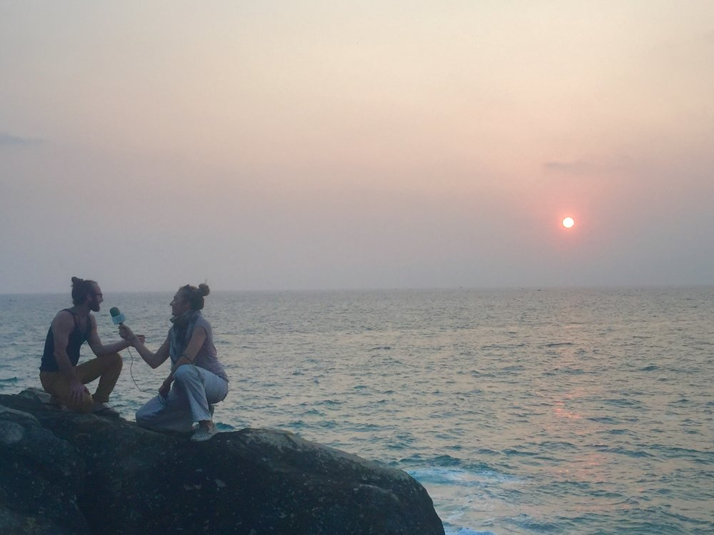 The rocks were perfectly hot from being baked by the Indian sun while Jason Shrader was interviewed during sunset in Kovalam, South India.