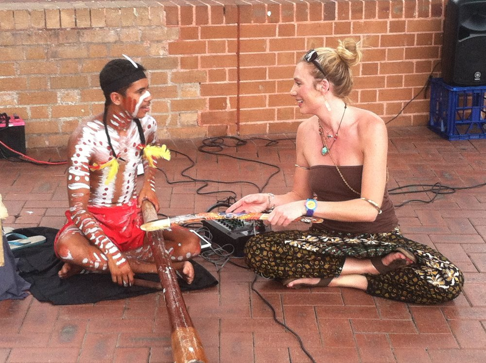 During the winter of 2013, Mandela recorded interviews in Australia. Here she sits with street musician, Jemia, whose father was featured on the show.