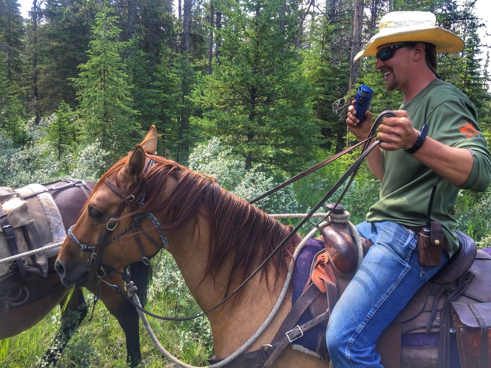 "Recorded this weekend on horseback in the heart of the Bob Marshall Wilderness in Montana. Clayton is a cowboy and wrangler for the K bar L Ranch (established in 1927) located where the North and South Fork of the Sun River meet. Clayton holds the microphone in the same hand holding the reins of his horse as the other holds a pack mule carrying fly fishing gear & cold beer. Clayton talks about why he is an advocate for bear spray, why it's important to spend time outside, why mules are amazing creatures & why he lives everyday to its fullest potential.  Clayton was born blind but after four surgeries and daily eye drops/medication he can see again. That said, doctors tell him that by the time he is in his 50s he will go blind.  Clayton is a beautiful soul who encourages everyone to be kind to one another & never take vision or your health for granted. This is a great interview recorded on the back of a horse and in the tall grass on the edge of the river in the hear of the ""Bob"". Yeeehaw!"
