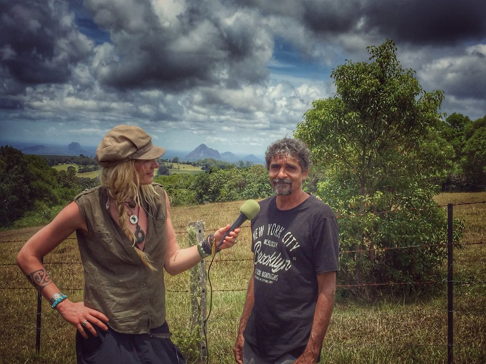 Interviewing a Kabi Kabi Indigenous Aboriginal Australian Elder at a sacred location where smoke signals were used to communicate with nearby tribes in order to ask & gain permission to cross into their land.