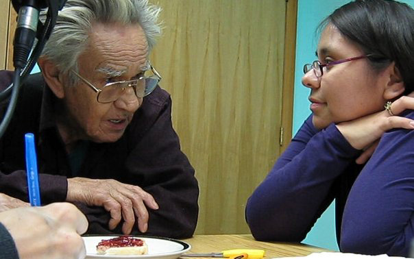 Kristy and Ts'inni Stephen working together closely to translate  her personal story  into the Haida language.