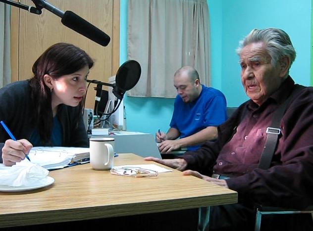 Lisa White clarifies what Tsinni is saying while Jordon Seward record the voices