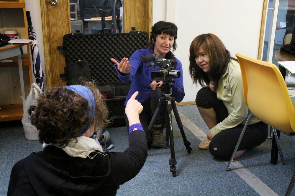 Roberta gets camera tips from mentors Sebnem and Barbara
