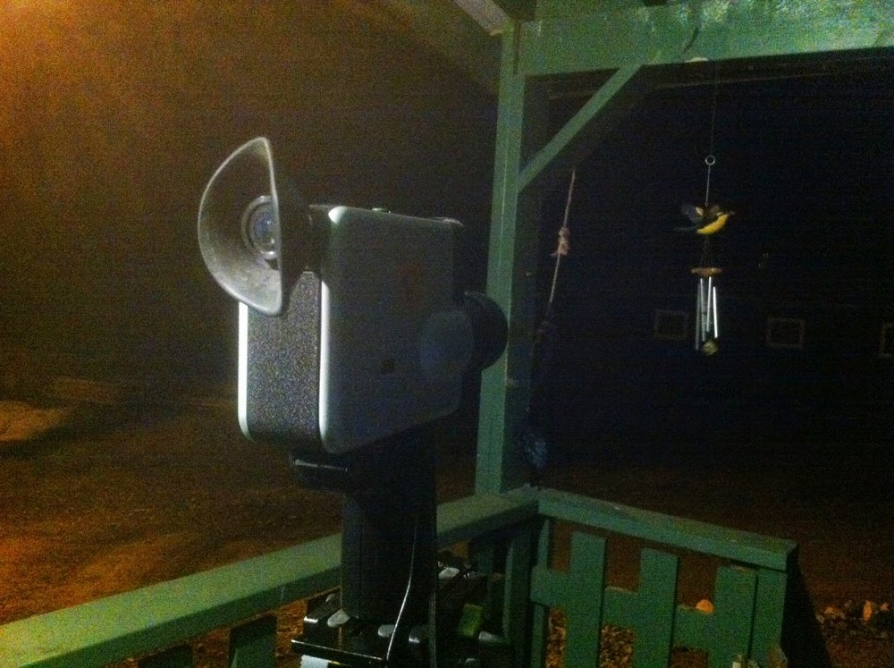 Late night/early morning filmming of a wind chime and the moon