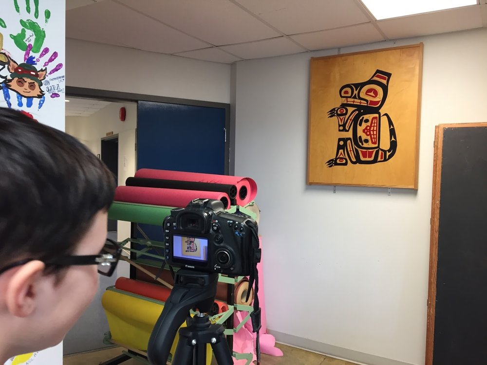 Mackenzie films artwork around the school to be used in the credit sequence