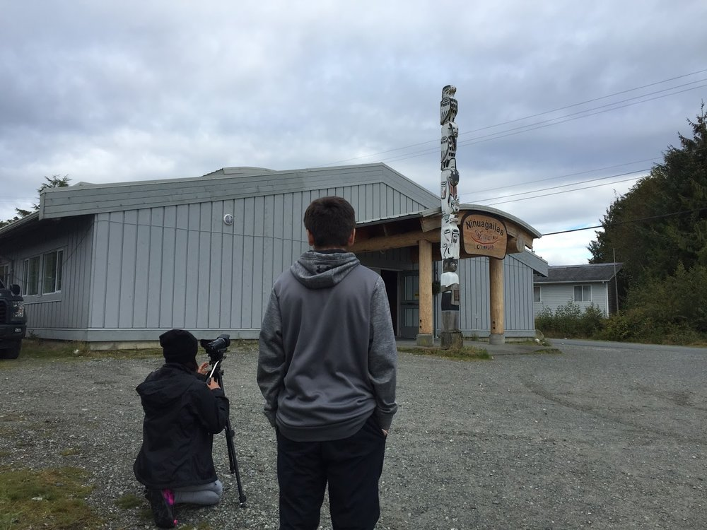 Nadia and Keyshawn capture b-roll of the totem poles around the village.