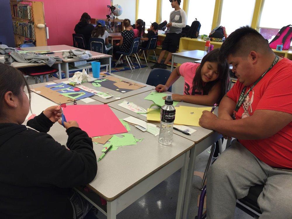 Teachers Assistant Mel, helps make artwork