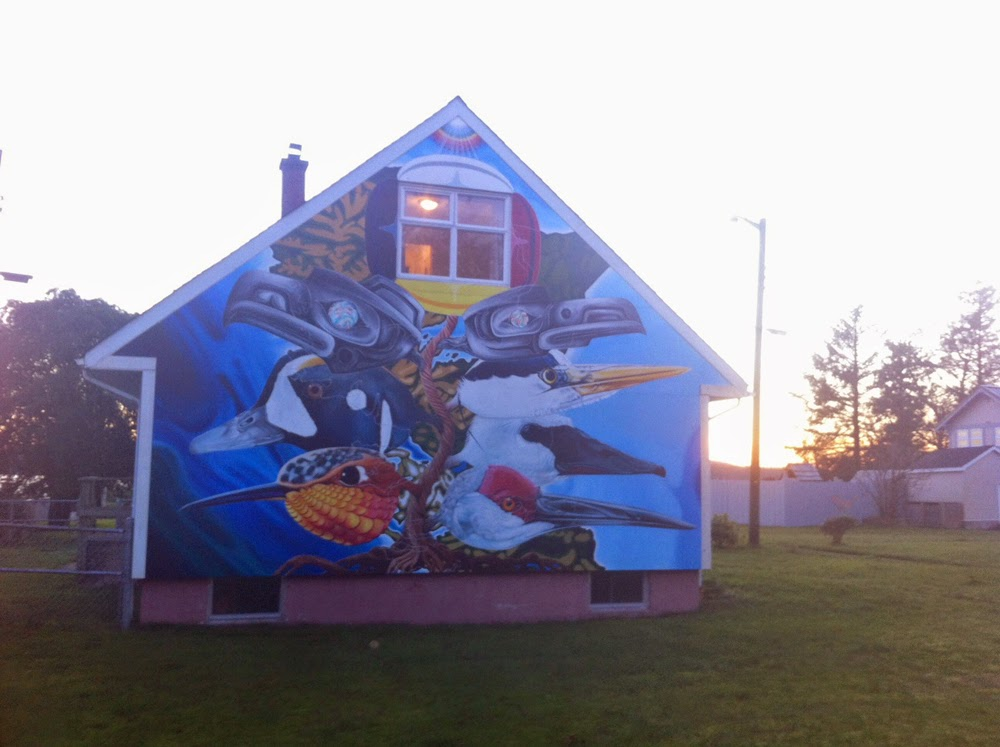 Thomas Arnatt painting on a house in Masset  walking home