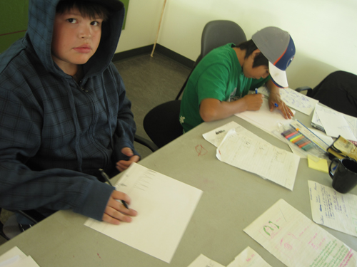 Nathaniel (left) and  Caleb work on their story.