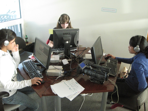 A trio of editors.  Melanya (to the left) works on her film about muskrat trapping, Brandie (to the right) and Sarah (center)