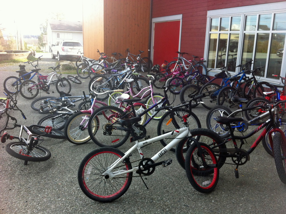 Check out the bike parking outside of the Bella Bella Community School! That's A LOT of bikes!