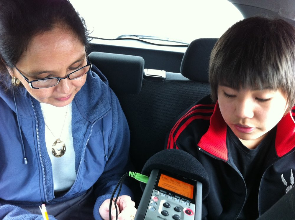 Eli's mom, Rhonda, helps Dorian with his Haida