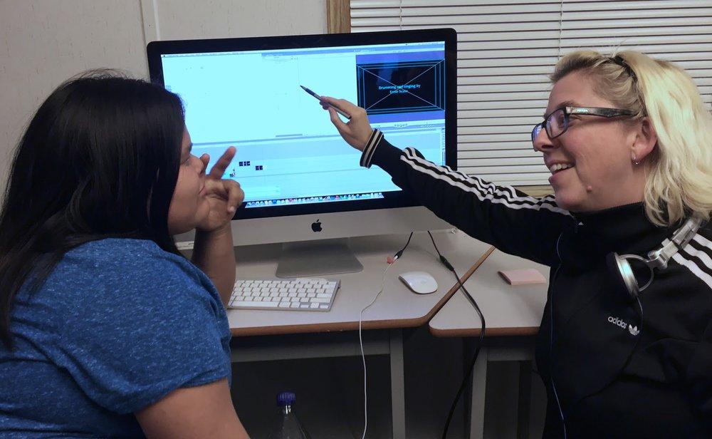 Mentor, Lisa g, shows Haley some titling tips