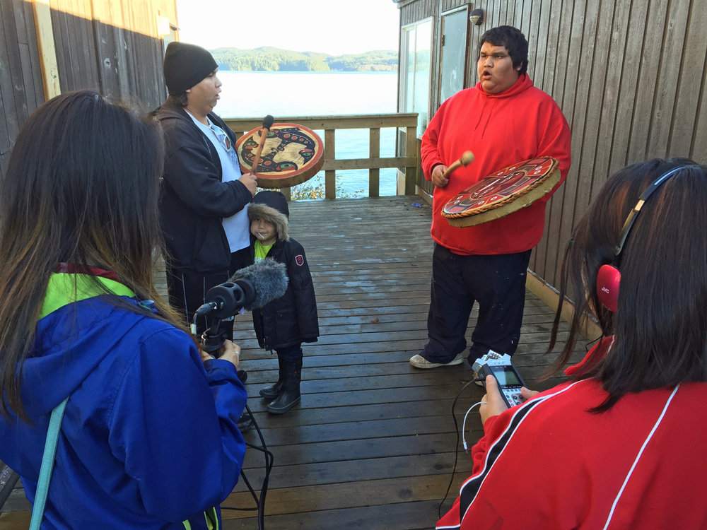 They sing the Gwa'sala-'Nakwaxda'xw Ladies Song for Thelma's film. Kelly helps record.