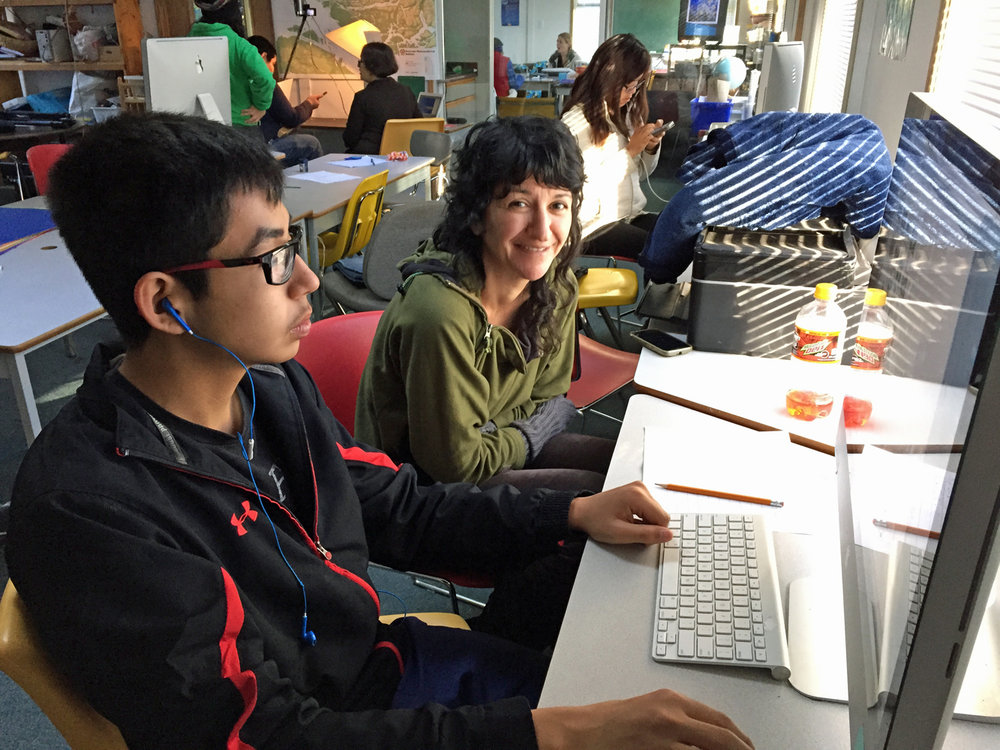 Alex works on finding some imagery of St Michael's Residential School with mentor, Sebnem