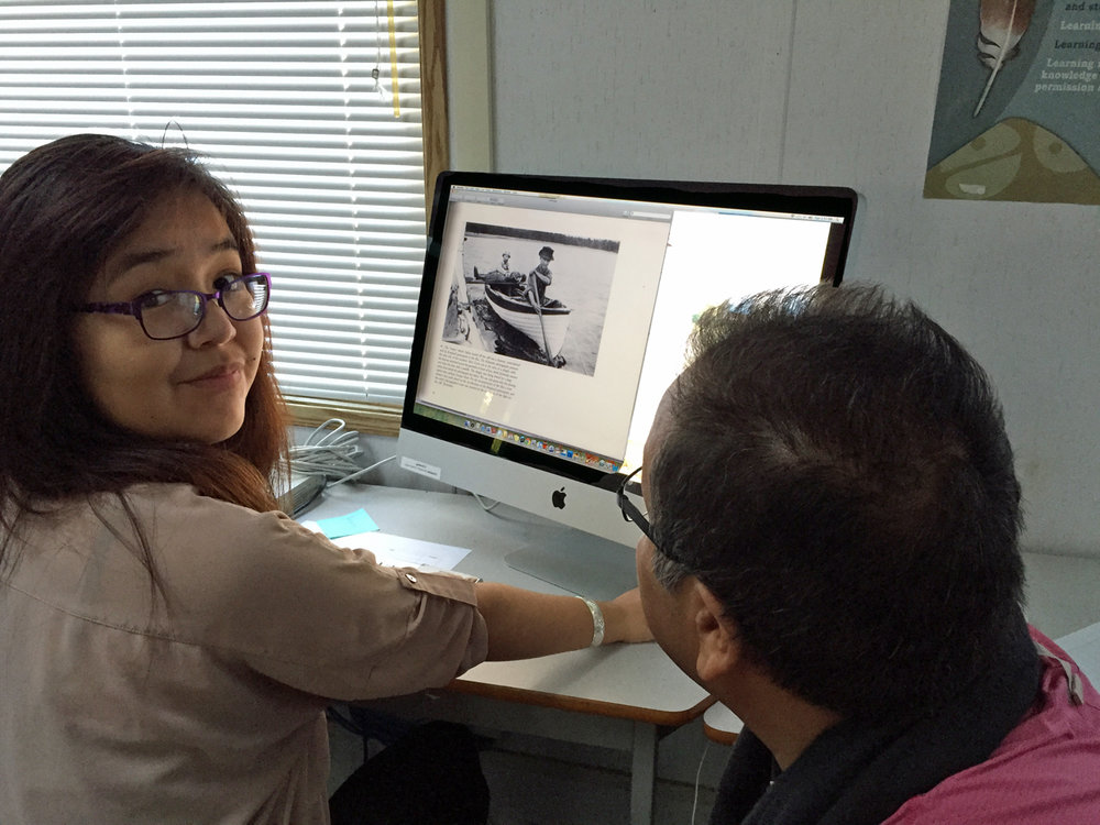 Roberta goes through archival material with student liaison, Richard