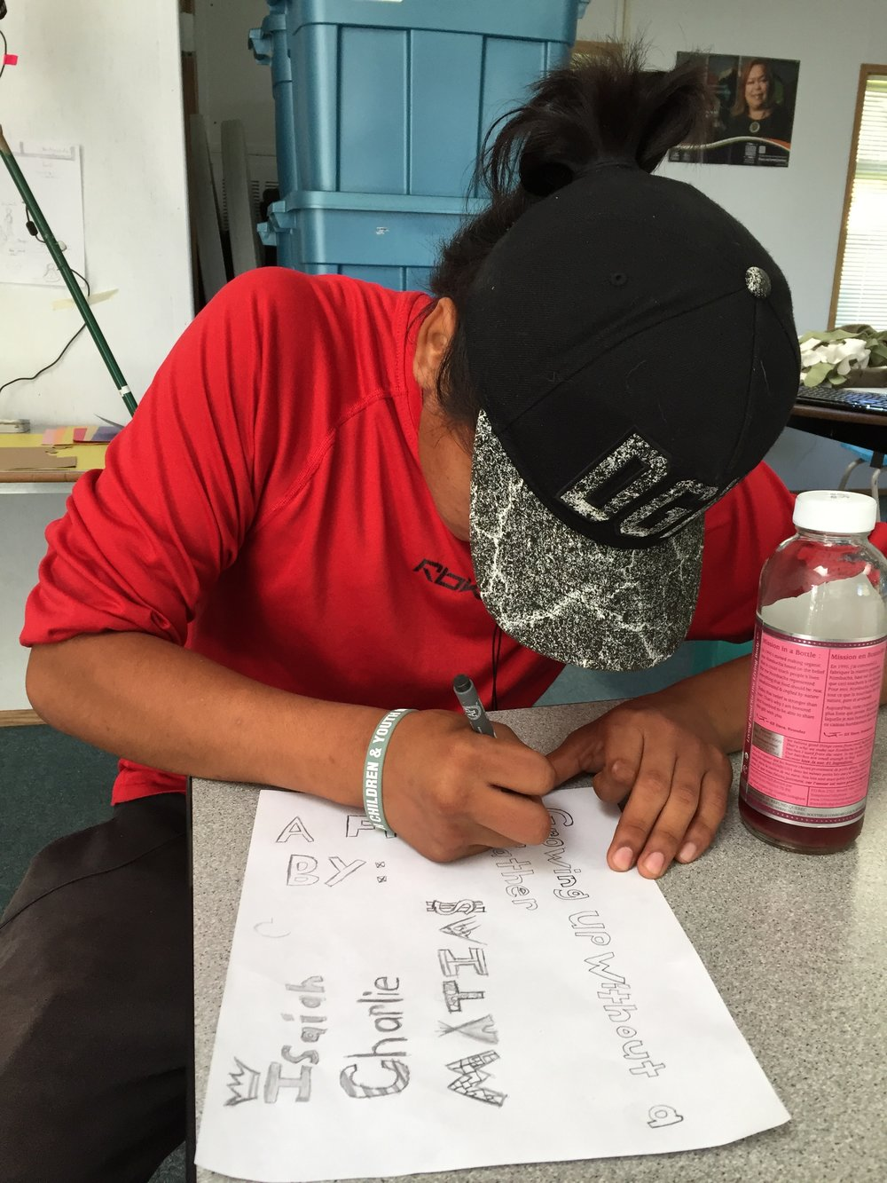 Isaiah creates the artwork for his credits.