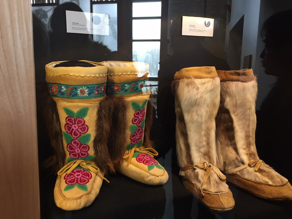 The artwork of Rosie's family. (Her grandmother created the boots on the left)