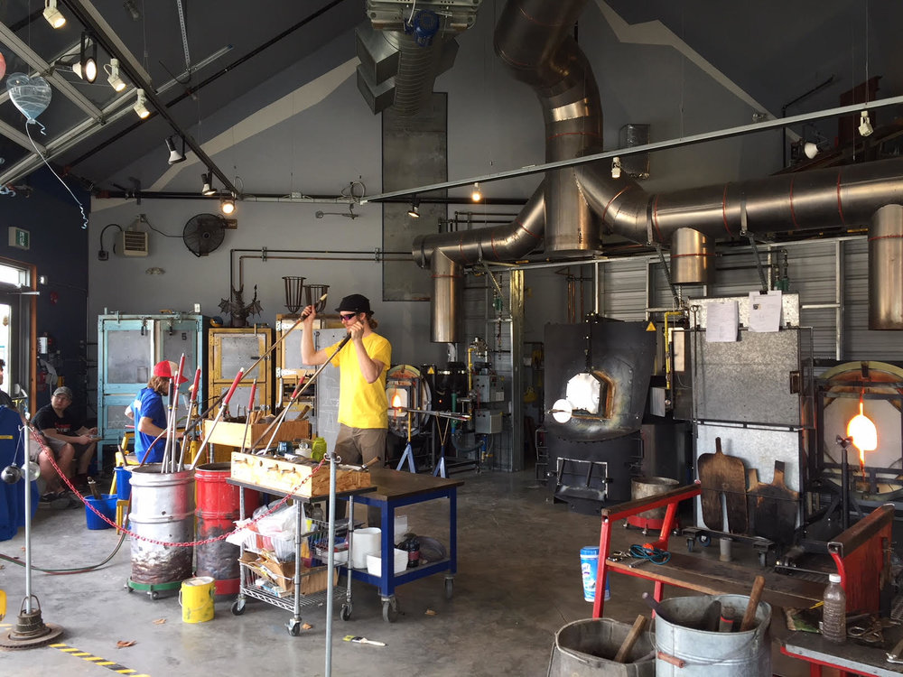 Glass blowers in action at the Lumel Studios