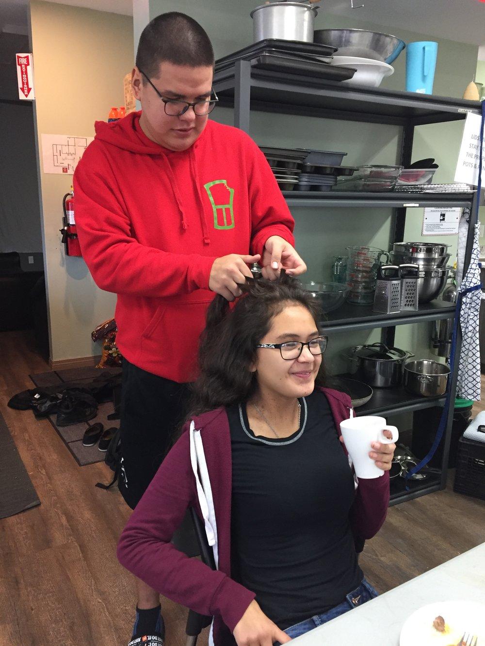 Howie braids Elle's hair