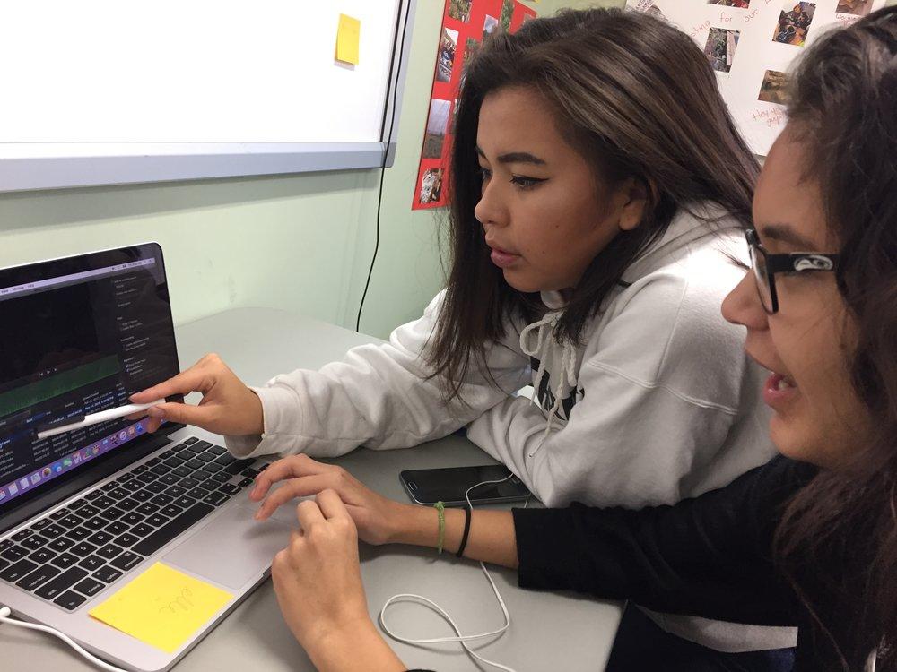 Latoya shows Elle how to import media