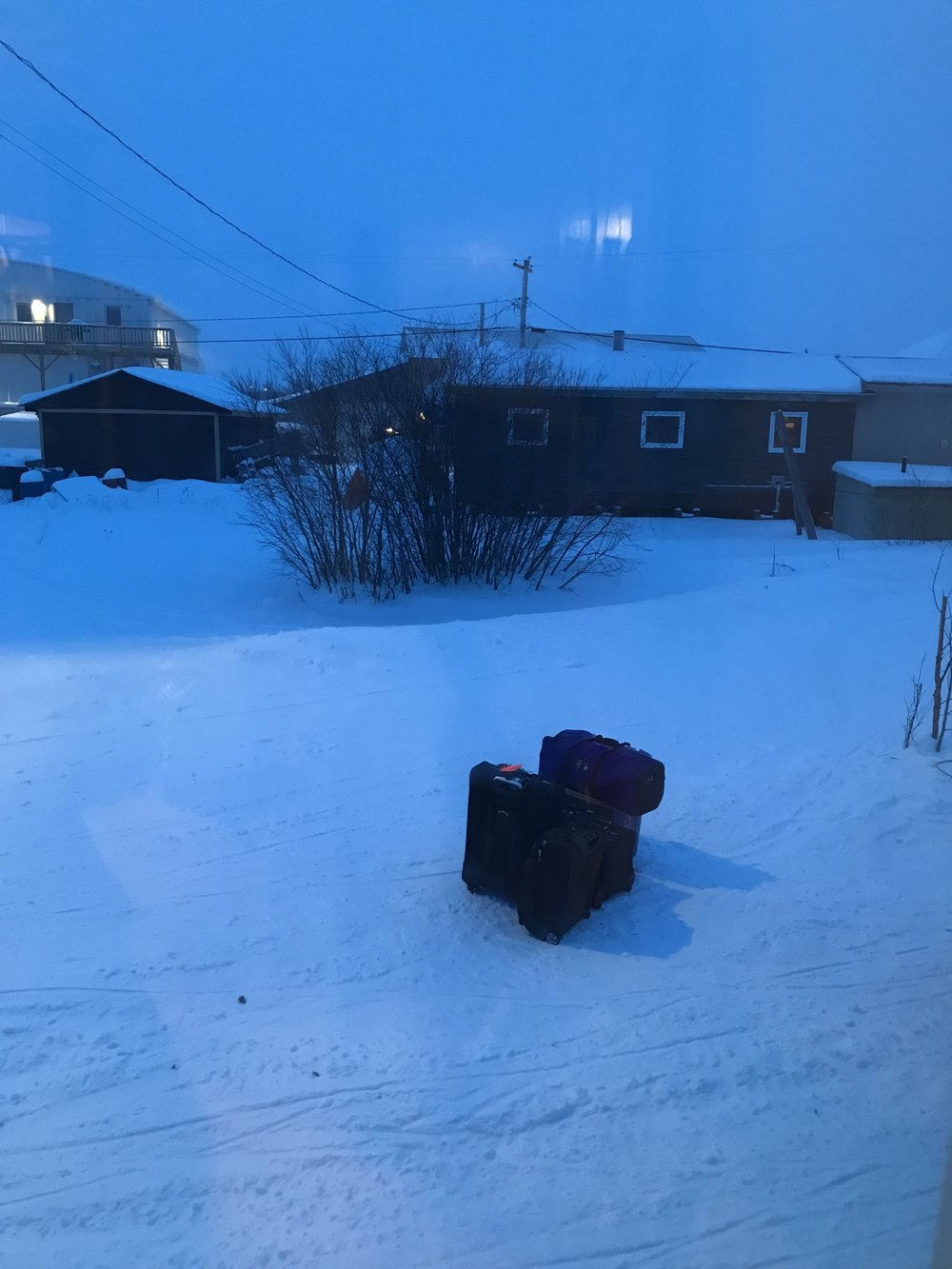 Our bags wait outside in the swirling snow…