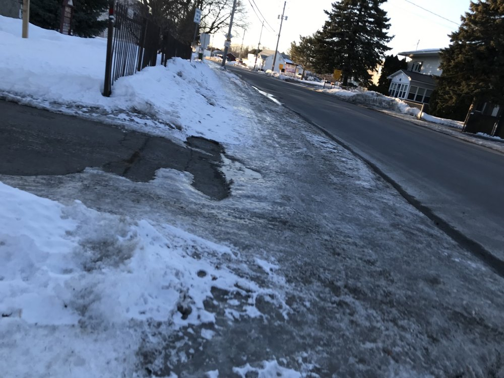 Due to the crazy weather of late (snowing, melting, more snow, more melt then freeze) some of the roads and sidewalks are covered in SOLID ICE