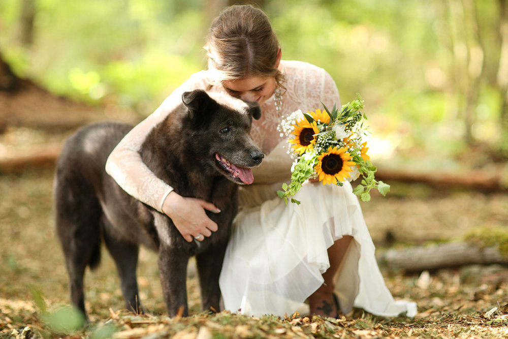 Bride with flowers and dog