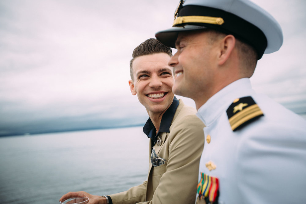 Same sex wedding photo of two grooms on a boat