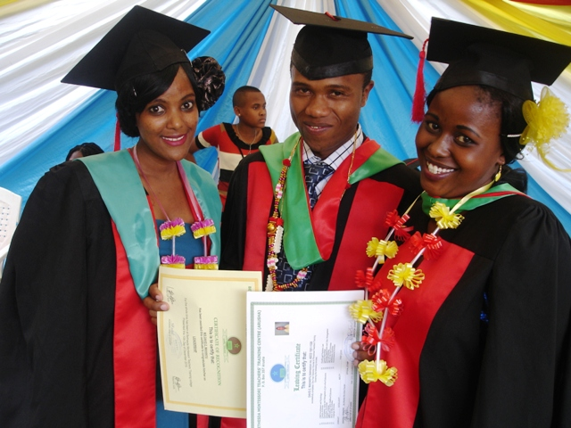 Former Umoja students David Mahanyu, Anneth Joram and Theofrida Innocent are shown celebrating their graduation from Teacher Training College. They completed their studies at Bethesda Teachers Training College and have been awarded a Diploma in Teaching.