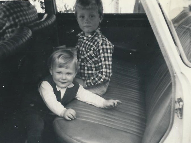 My brother and I in the back seat.