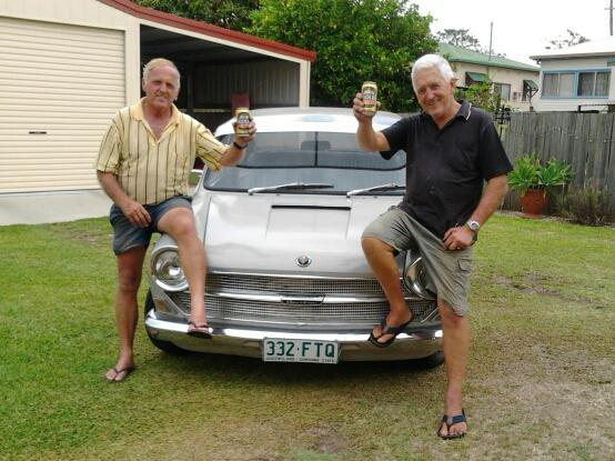 "Here is a photo that they texted me celebrating the initial repairs mile stone and after my uncle taking the 1800 for a drive around the back yard - it's a large block (my father on the right, my uncle the left). I replied ""Where's my beer and get off my bonnet!"