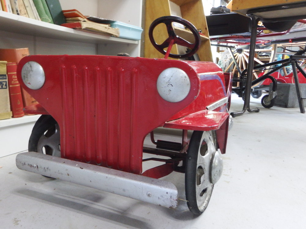 An old pedal car