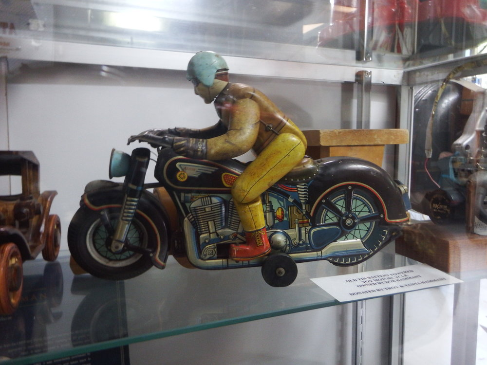Old tin battery powered toy motorcycle