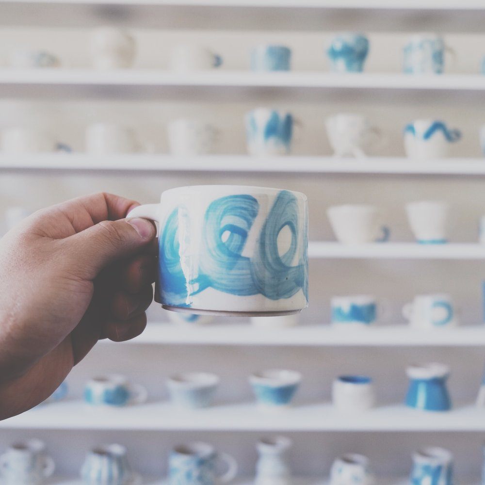 #100daysofmugs was a project in response to the #100dayproject. The project explored the boundaries of process by pushing myself to create something new day in, day out.  Inspiration was drawn from many sources, in particular my travels abroad to Turkey and Japan. Blue was the colour of choice for the project, an ode to the beautiful mosques, tiles and jewellery encountered through my travels. I also gained much of my inspiration from nature. These simple forms are reflected in the textures and shapes of the mugs I created.  Each piece has explored the concept of form, function and shape, going beyond the boundaries of functionality and into the realm of abstract art.