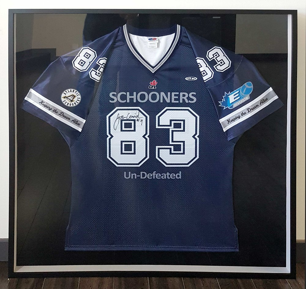 Framed sports jersey (football) in custom shadowbox frame