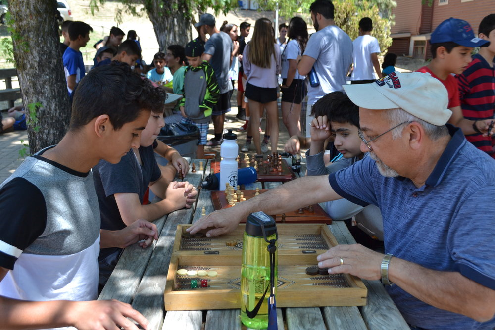 Playing  tavloo  with Fr. Sarkis.