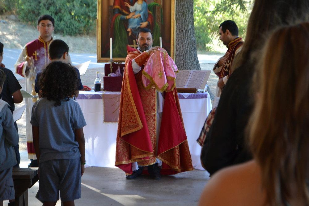 Der Hovel leading The Divine Liturgy (Badarak)