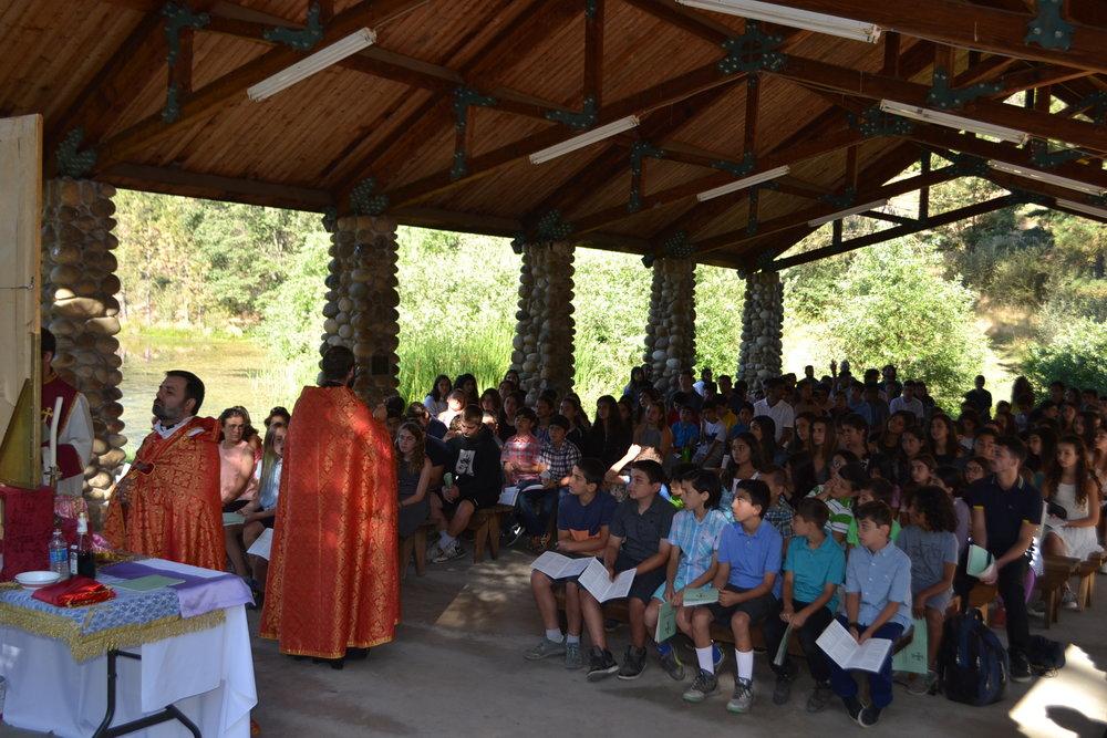 Campers listening to Der Mesrop's sermon