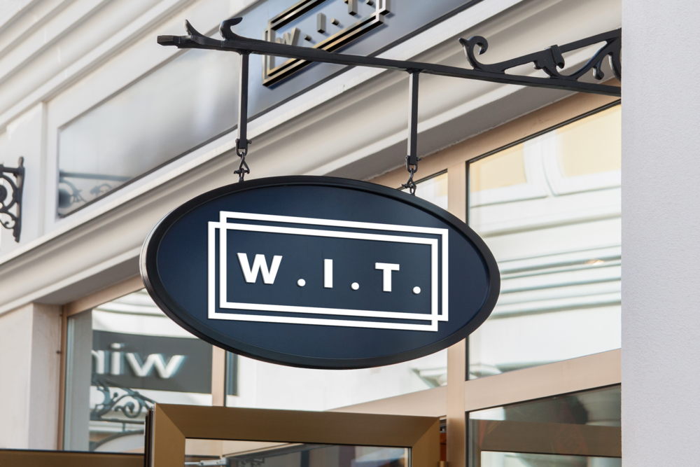 W.I.T. Storefront sign with metal sign above the door