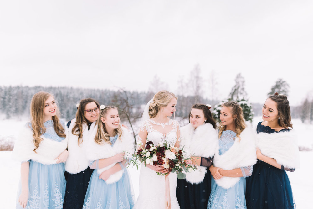 The bridesmaids really appreciated having these to cover their shoulders whilst snow was falling in Southern Finland.