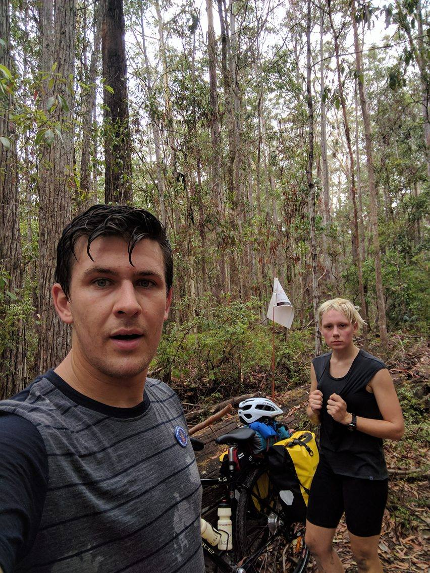 "3 hours into a 6 hour slog (only 15 kms) to the Wanggoolba barge off the island. Through tropical heat (that is sweat not rain), mosquitoes, sand, over grown walking tracks here is a shot of the two happy campers. Bobbie's catch phrase for the day was ""get me off this island!"""