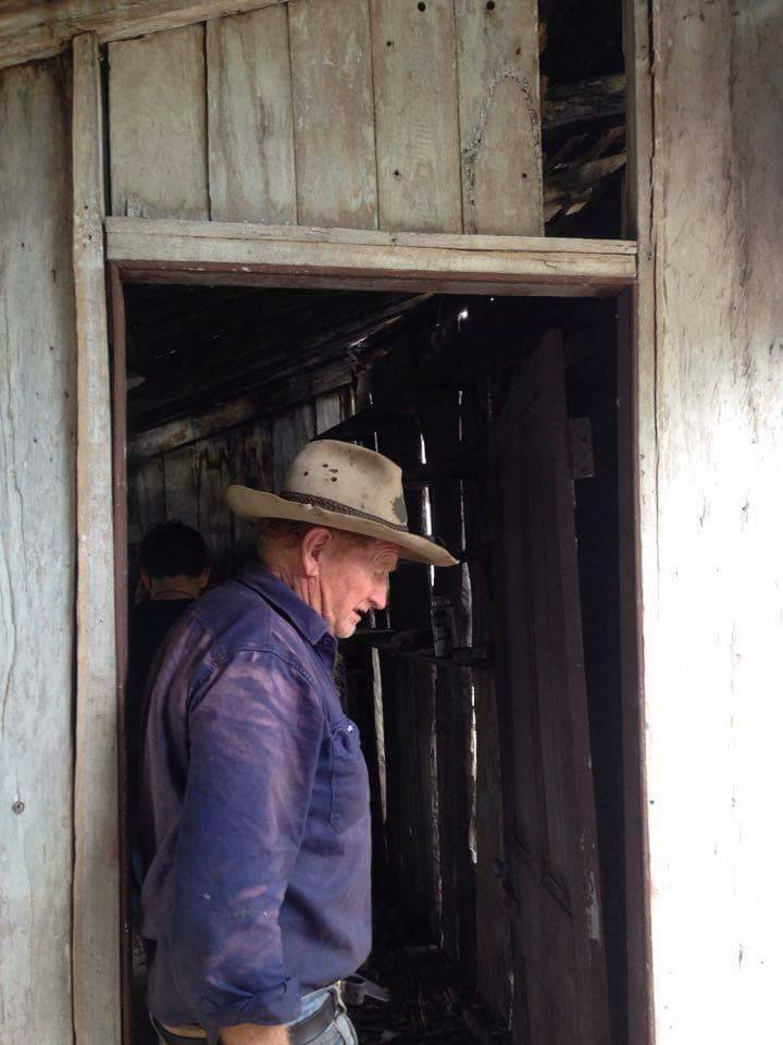 Dennis, the owner of Old Walloon homestead showing us around the falling down slab hut