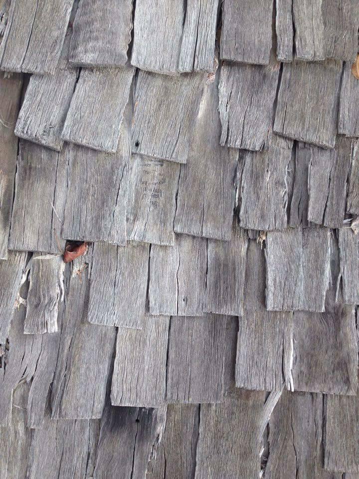 Rough yet regular timber shingles.