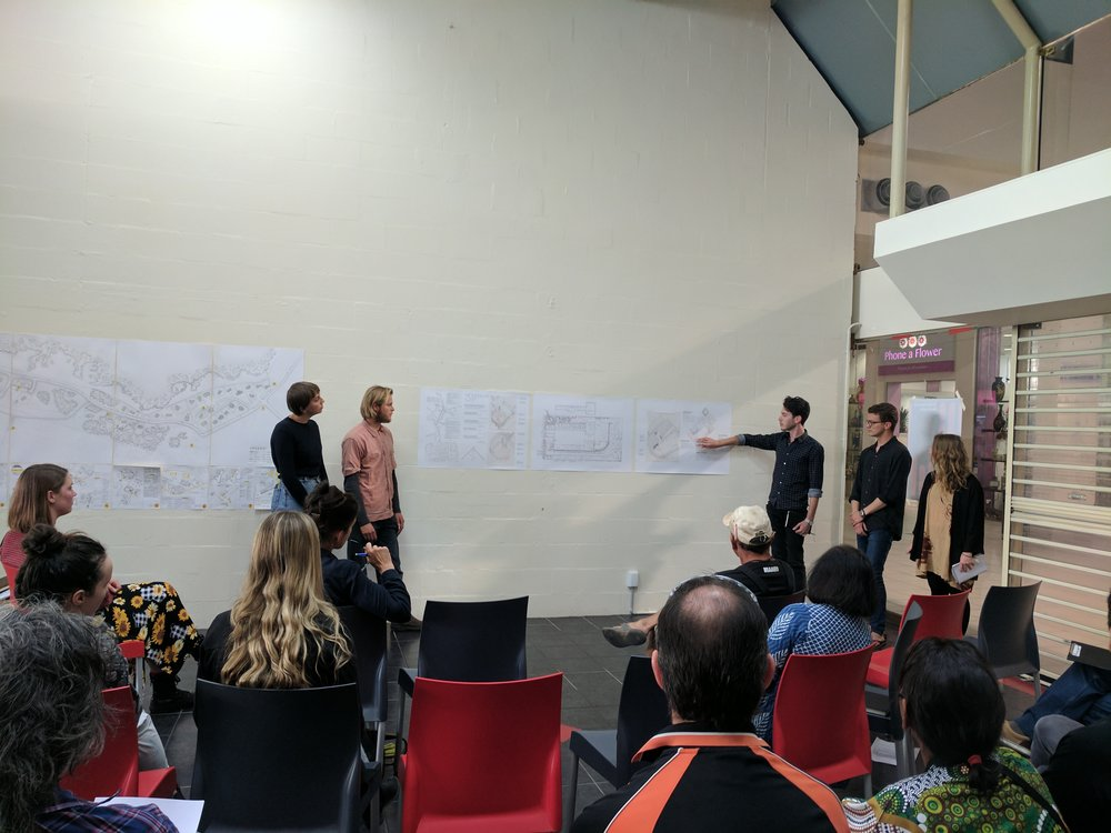 UON students presenting, inside mall shopfront