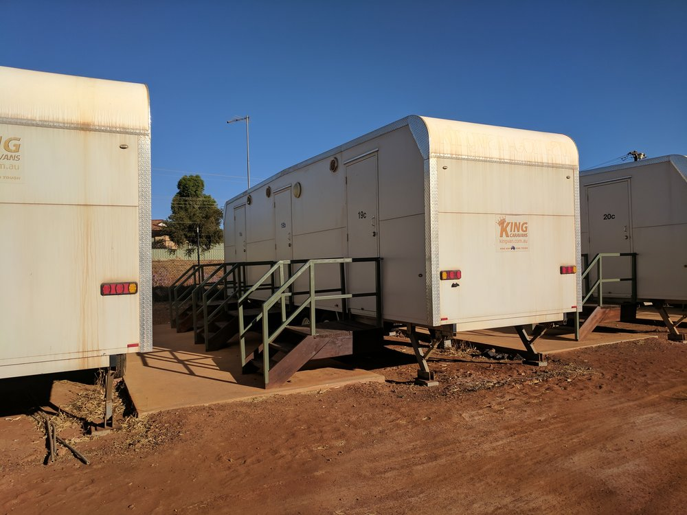 Caravan park accomodation. Donga/caravan, reliant on air-con and sitting out-side for space.