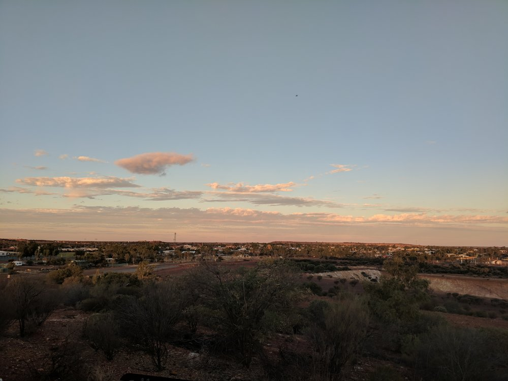 View over Meekatharra from the south-east. Standing atop the waste pile of unused Luke's mine (seen to lower right), the town lookout has found a home.
